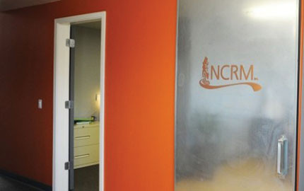 Metal door at NCRM with Logo