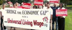Group of Universal Living Wage supporters holding banner in front of the group
