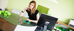 Young woman sitting and thinking at office desk