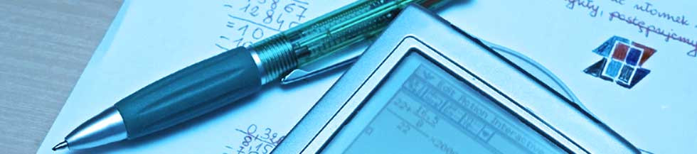 Macro picture of a pen electronic organizer on top of  paper notes