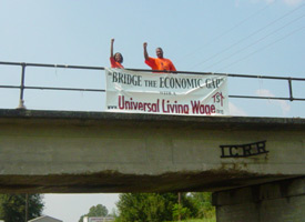 Supporters holding up banner on a bridge in Mississippi