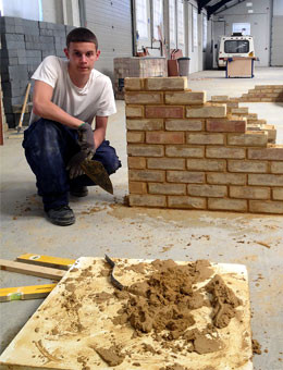 Construction student with his brick wall