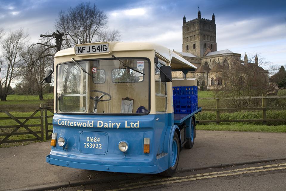 Cotteswold Dairy Milk Float delivering milk in bottles